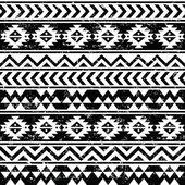 Aztec tribal seamless grunge white pattern on black background — Stock Vector