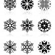 Snowflakes icon set on black and white background — Stock Vector