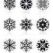 Snowflakes icon set on black and white background — Stock Vector #47873923