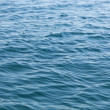 Weak ripples on blue water — Stock Photo