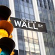 Wall Street Sign and yellow traffic light, New York — Stock Photo
