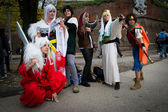Groups of costumed players — Stock Photo