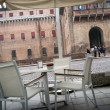 Snack bar in front of castle of Ferrara — Stock Photo #15840071