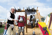 Knight shows the parts of medieval armor — Stock Photo