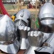 Постер, плакат: Helmets and pieces of medieval armor