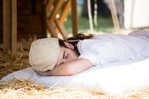 Boy with medieval costume sleeping — Stock Photo