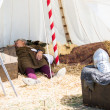 Stock Photo: Mwith medieval costume sleep in tend