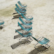 Empty deck chairs on the sand — Stock Photo