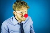 Man with a clown nose — Stockfoto