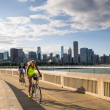 Stock Photo: Cyclists in Chicago during sunset