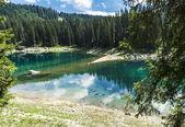 Carezza's lake colors in summer season — Stock Photo