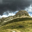 Stock Photo: Storm clouds over Mount Castellazzo