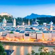 Stock Photo: Panoramic view of Salzburg skyline with river Salzach at dusk, Salzburger Land, Austria