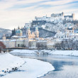 Salzburg skyline with Festung Hohensalzburg and river Salzach in winter, Salzburger Land, Austria — Stock Photo #24223863