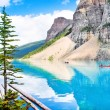 Beautiful landscape with Rocky Mountains and tourists canoeing on azure mountain lake, Alberta, Canada — Stock Photo