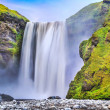 Long exposure of famous Skogafoss waterfall in Iceland at dusk — Stock fotografie