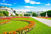 Mirabell Gardens with Fortress Hohensalzburg in the background in Salzburg, Austria — Stock Photo