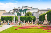 Mirabell Gardens with Fortress Hohensalzburg in the background in Salzburg, Austria — Stock Photo