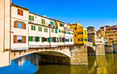 Ponte Vecchio with river Arno at sunset in Florence, Italy — Stock Photo