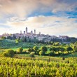 Stock Photo: Beautiful landscape with the medieval city of San Gimignano at sunset in Tuscany, Italy