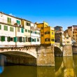 Ponte Vecchio with river Arno at sunset in Florence, Italy - Stock Photo
