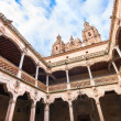 Famous Patio de la Casa de las Conchas with La Clerecia Church in Salamanca, Castilla y Leon, Spain — Stock Photo