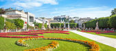 Panoramic view of famous Mirabell Gardens with the old historic — Stock Photo