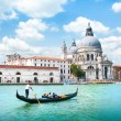 Gondola on Canal Grande with Basilica di Santa Maria della Salute in the background, Venice, Italy — Stock Photo