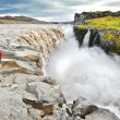 Stock Photo: Womstanding near famous Dettifoss waterfall in Vatnajokull National Park, Iceland