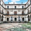 Famous Courtyard of the Fountainheads (Patio de los Mascarones) at Royal Monastery of San Lorenzo de El Escorial near Madrid, Spain — Stock Photo