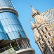 Stock Photo: Beautiful view of Haas Haus with famous St. Stephen's Cathedral on a sunny day in Vienna, Austria