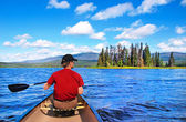 Man canoeing on a lake in the wilderness of British Columbia, Canada — Stock Photo