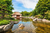 Beautiful view of traditional Japanese Garden with tea house and pond — Stock Photo