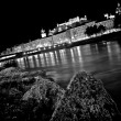 Stock Photo: Artistic view of city of Salzburg with river Salzach at night in black and white, Salzburger Land, Austria