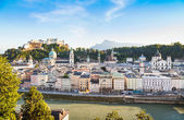 Panoramic view of Salzburg skyline with river Salzach at sunset as seen from Kapuzinerberg, Salzburger Land, Austria — Stock Photo