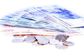 Coins and banknotes on a white background isolated — Stock Photo