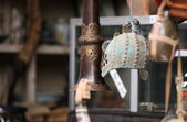 Antique devices: old iron helmet, tibetan trumpet, and some more bizarre items. — Stock Photo