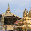 Stock Photo: Gilded statues and roof decoration, Swayambhunath Stupa.