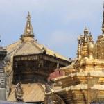 Gilded statues and roof decoration, Swayambhunath Stupa. — Stock Photo