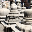 Stock Photo: Small stupas sorrounding Swayambhunath Stupa.