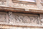 Richly carved wooden window frame. — Stock Photo