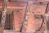 Patan-three carved wood roof beams in Mul Chowk. — Stock Photo