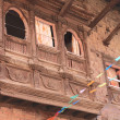 Stock Photo: Old wooden balcony in Patan.