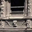 Stock Photo: Richly carved dark wood window-Patan-Nepal.