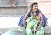 Old homeless woman. Durbar Square-Kathmandu. — Stock Photo