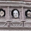 Stock Photo: 0194 Masks hanging on carved window. Durbar Square-Kathmandu-Nepal.