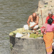 Stock Photo: Bhattpriest-two faithful women. Pashupatinath temple-Bagmati river-Deopatan-Kathmandu-Nepal. 0288