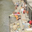 Stock Photo: Hindu faithfuls and bhattpriests-Bagmati river-Pashupatinbath temple-Deopatan-Kathmandu-Nepal. 0287