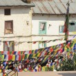 Stock Photo: Buildings and prayer flags around Boudhanath-Bodhnath stupa. Kathmand-Nepal. 0319