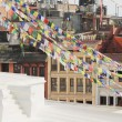 Stock Photo: Buildings around Boudhanath-Bodhnath stupa. Kathmandu-Nepal. 0318